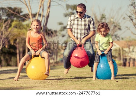 Dad and children playing on the lawn in front of house at the day time #247787761