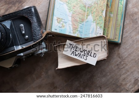 """text """"The World Awaits"""" and book, travel, tour, tourism concept #247816603"""