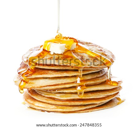 Stack of Small pancakes in syrup on white background Royalty-Free Stock Photo #247848355