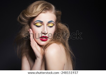 Beauty blonde woman portrait with creative pop art make up like marilyn monroe style on a fresh clean skin. dark neutral background. copy space