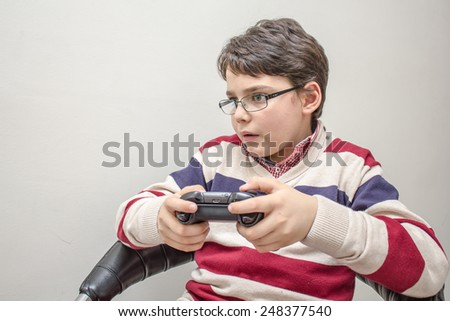 Child with a game controller  #248377540