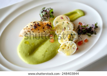 To Tani Ripieni - Squids, stuffed with their own tentacles and potatoes, served with green peas puree and fresh parsley pesto #248403844
