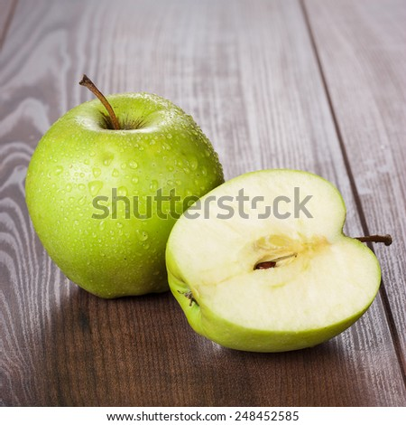 fresh green apples on the brown wooden table #248452585