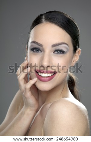 Close-up portrait of a beautiful young woman looking at camera  #248654980