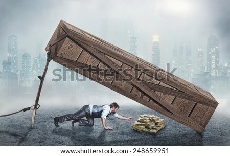Man trying to get money in trap Royalty-Free Stock Photo #248659951