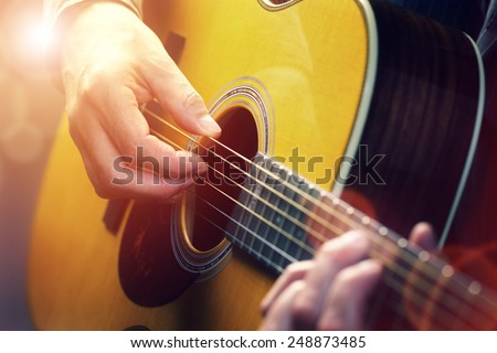 Man playing an acoustic guitar #248873485