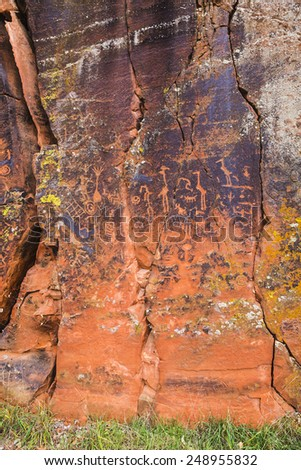 Large rock panel with many symbolic petroglyphs