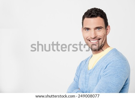 Handsome happy man posing with folded arms #249008077