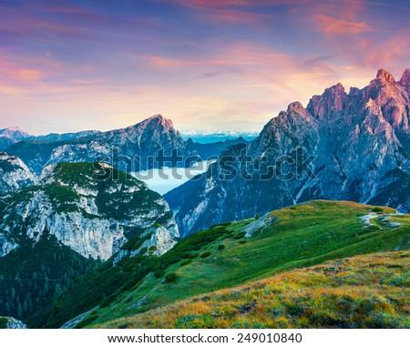 Colorful sunrise on the Seekofel mountain range in National Park Tre Cime di Lavaredo. Dolomites, South Tyrol. Location Auronzo, Italy, Europe. #249010840