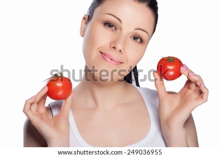 Beautiful close-up portrait of young woman with tomato. Healthy food and vegetables concept. Skin care and beauty. Vitamins and minerals. #249036955
