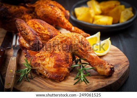 Tasty baked chicken with herbs and lemon #249061525