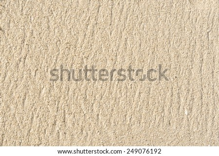 Textured background of sand on the beach. #249076192