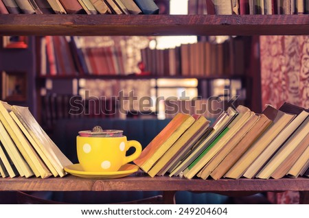 Library bookshelf and yellow cup - Old fashioned style