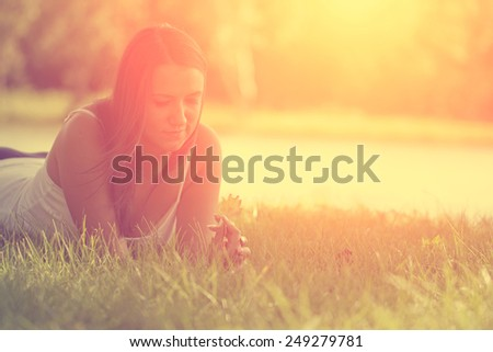 Relaxing woman on grass #249279781