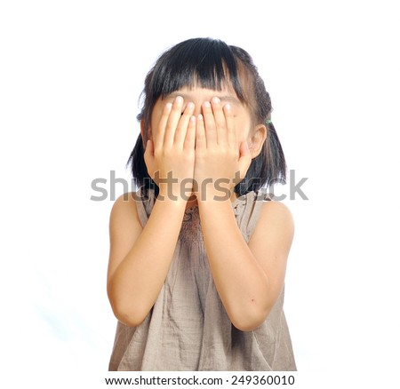 asian little girl cover her face with her hand isolated in white background #249360010