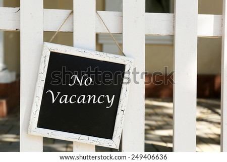 Signboard with text No Vacancy near hotel #249406636