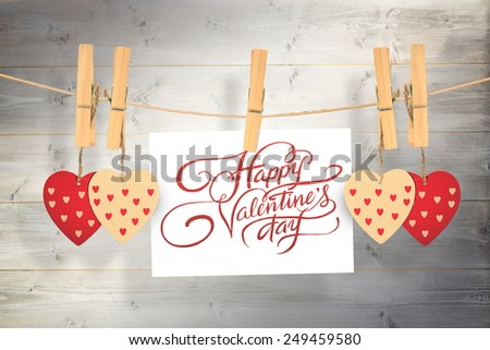 Happy valentines day against bleached wooden planks background #249459580