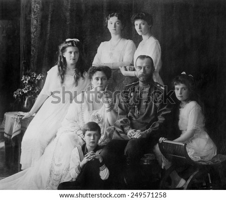 Russian Royal family in 1914. L-R Seated: Marie, Queen Alexandra, Czar Nicholas II, Anastasia, Alexei. Standing: Olga and Tatiana.