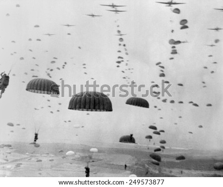 Allied aircraft drop paratroopers into German held Netherlands, for Operation Market Garden. The plan to capture key bridges in Netherlands failed with 15,000 Allied casualties. Royalty-Free Stock Photo #249573877
