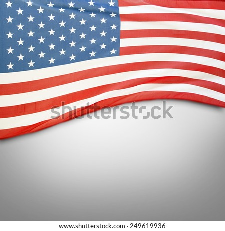 Closeup of American flag on grey background #249619936