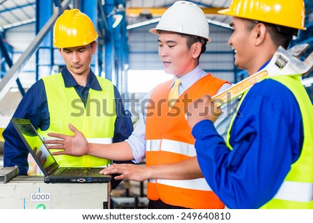 Team of workers and engineer  in Factory at production training with laptop #249640810
