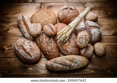 fresh bread  and wheat on the wooden #249697642
