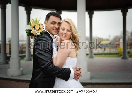 close up portrait of a beautiful young just married couple #249755467
