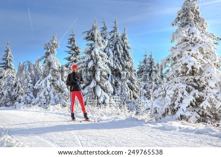 A man cross-country skiing on the forest trail #249765538