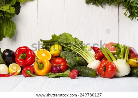 Fruit and vegetable borders on white wooden old table #249780127