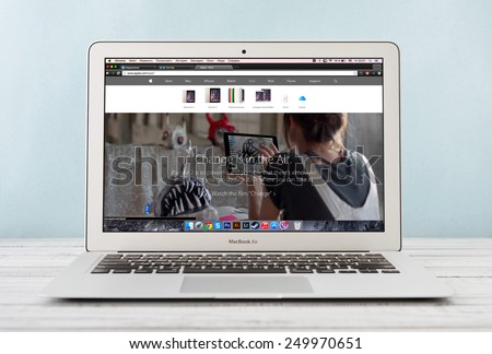 KIEV, UKRAINE - JANUARY 29, 2015: Brand new Apple MacBook Air Early 2014 with page presenting new iPad Air 2 on screen, designed and developed by Apple Inc., it was released on April 29, 2014 #249970651