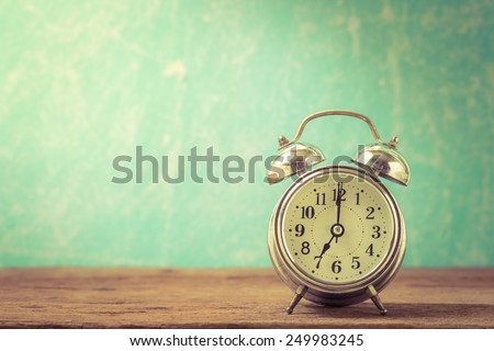 Vintage background with retro alarm clock on table #249983245