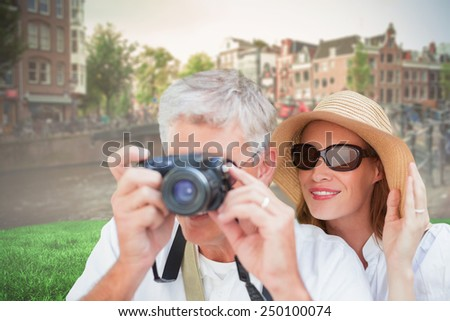 Vacationing couple taking photo against sunny day in amsterdam