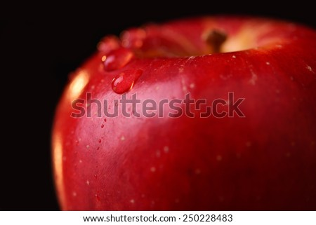 Red organic apple with water drops on a black background. Macro water drops #250228483