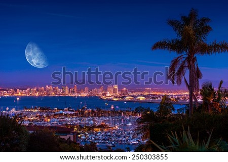 San Diego Night with Large Moon on the Horizon. San Diego Night Time Panorama. California, United States.