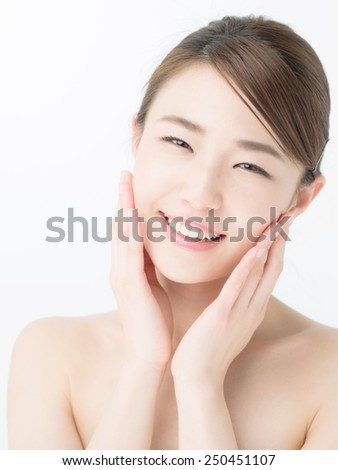 attractive asian woman skin care image on white background #250451107