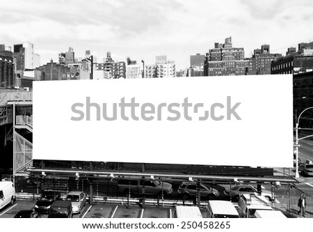 Big blank billboard sign in New York City, surrounded by highrise buildings. Black and white image ready for custom copy.