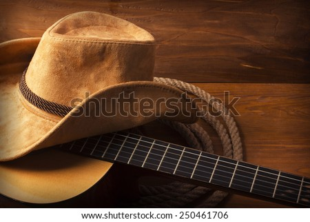 American Country music background with guitar and cowboy hat Royalty-Free Stock Photo #250461706