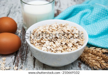 Bowl of oats on a old wooden background #250669102