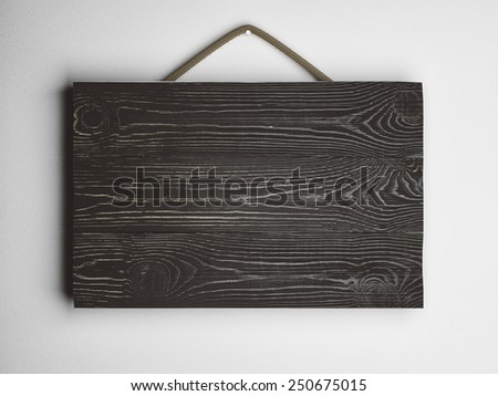 plate frame of three black wooden planks
