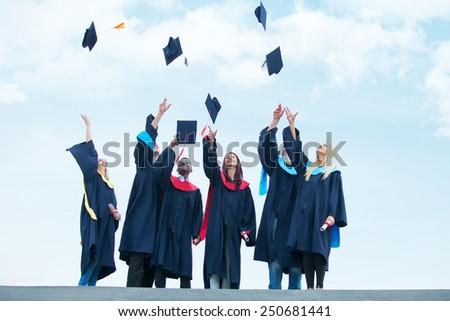 group of graduates celebrating outdoors #250681441