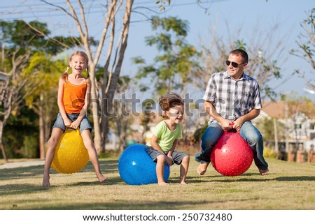 Dad and children playing on the lawn in front of house at the day time #250732480