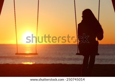 Single woman alone swinging on the beach and looking the other seat missing a boyfriend #250745014