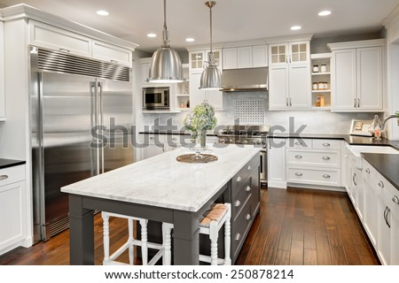 kitchen interior in new luxury home Royalty-Free Stock Photo #250878214