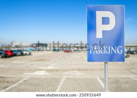 Parking lot with number of authorized parking sign