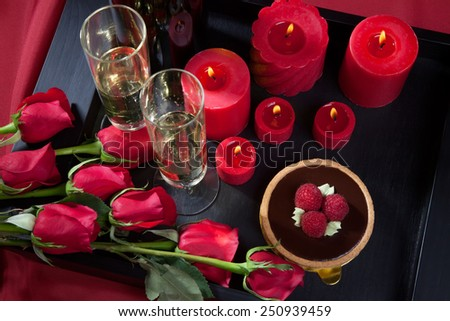 Celebration tray for Valentines Day - Champagne, chocolate raspberry cake, candles, and red roses.  #250939459