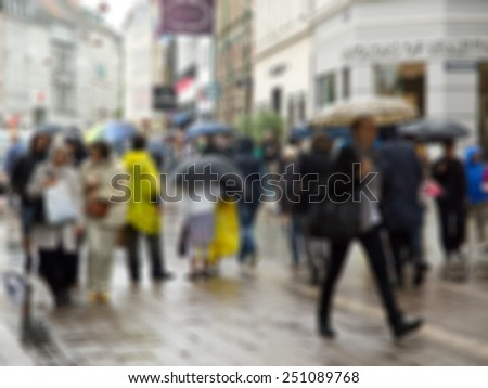blurred raining city and people urban scene