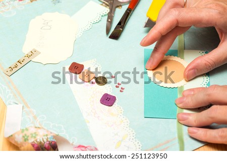 scrapbook background. Card and tools with decoration   Royalty-Free Stock Photo #251123950