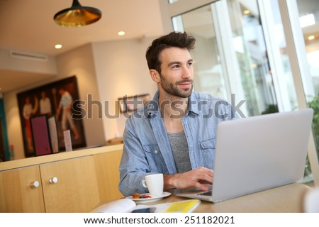 Man working on laptop computer from home #251182021