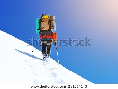 Climber on snowy summit #251264143