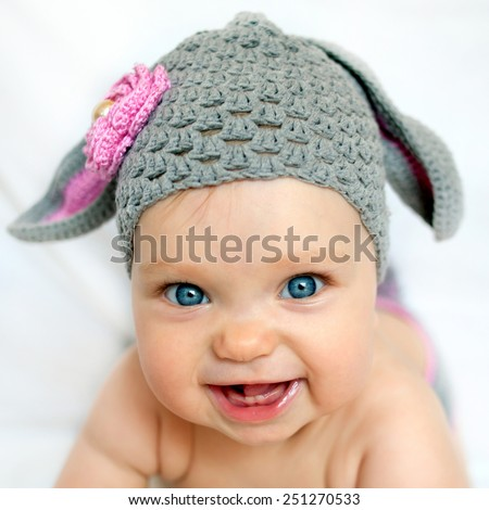 Happy baby in the hat like a bunny or lamb #251270533
